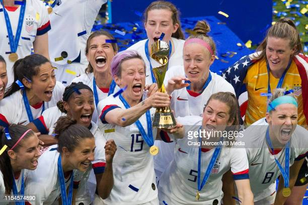 Megan Rapinoe of USA lifts the winners trophy and celebrates with team mates after the 2019 FIFA Women's World Cup France Final match between The...