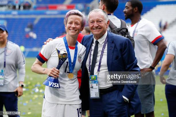 Megan Rapinoe of USA poses for a photo with JeanMichel Aulas President of Olympique Lyonnais after the victory of the 2019 FIFA Women's World Cup...