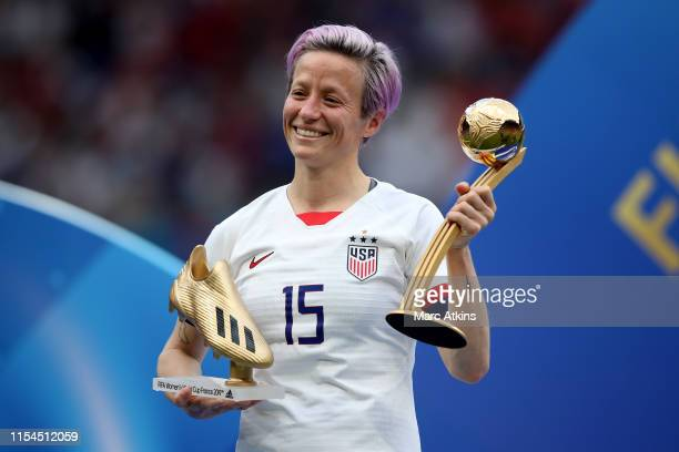 Megan Rapinoe of USA poses with her Golden boot and player of the tournament awards during the 2019 FIFA Women's World Cup France Final match between...