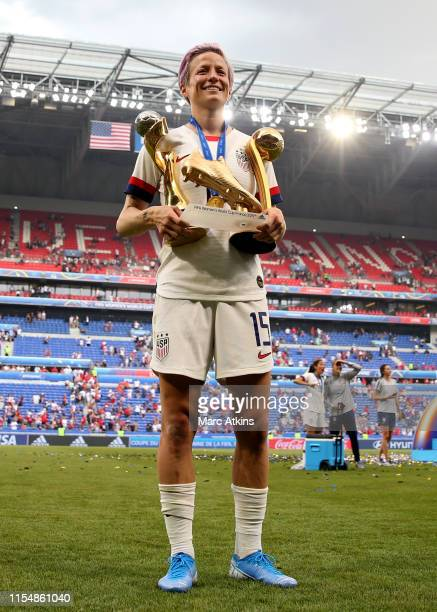 Megan Rapinoe of USA poses with trophies after the 2019 FIFA Women's World Cup France Final match between The United States of America and The...