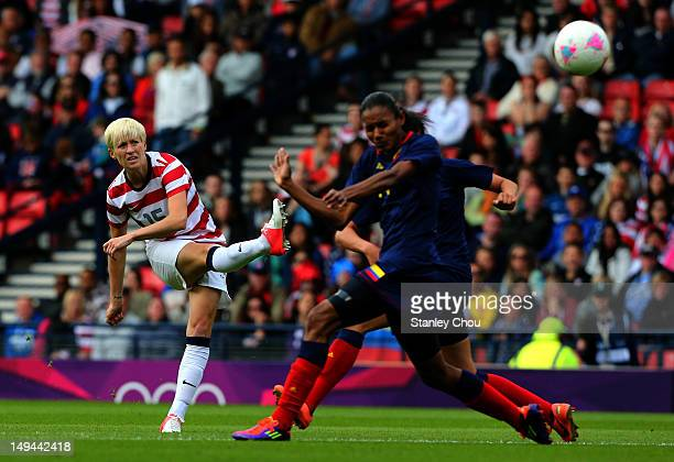 Megan Rapinoe of USA scores the opening goal during the Women's Football first round Group G match between United States and Colombia on Day 1 of the...