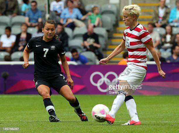 Megan Rapinoe of USA shields the ball away from Ali Riley of New Zealand during the Women's Football Quarter Final match between United States and...