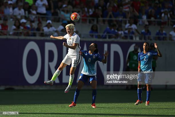 Megan Rapinoe of USWNT heads the ball in front of Thaisa of Brazil during a women's international friendly soccer match between Brazil and the United...