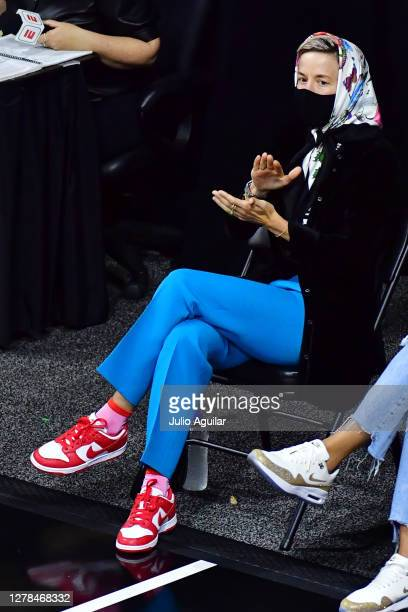 Megan Rapinoe reacts after a basket during the first half of Game Two of the WNBA Finals between the Las Vegas Aces and the Seattle Storm at Feld...