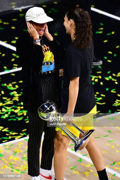 Megan Rapinoe reacts to Sue Bird of the Seattle Storm after the Storm defeated the Las Vegas Aces in Game 3 of the WNBA Finals to win the...