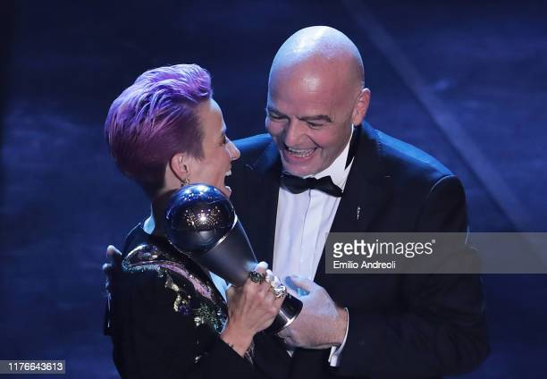 Megan Rapinoe receives The Best FIFA Women's Player of the Year award by FIFA President Gianni Infantino during The Best FIFA Football Awards 2019 at...