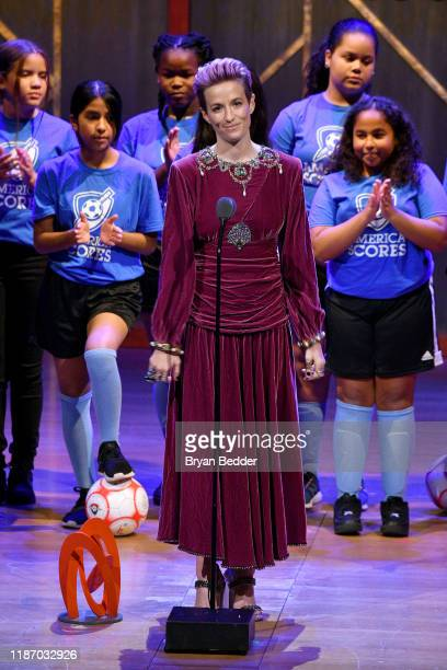 Megan Rapinoe speaks onstage alongside the Mott Hall Girls soccer team at the 2019 Glamour Women Of The Year Awards at Alice Tully Hall on November...
