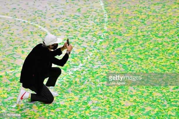 Megan Rapinoe takes a picture of the Seattle Storm during the WNBA Championship presentation following Game 3 of the WNBA Finals against the Las...