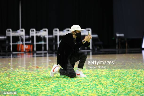 Megan Rapinoe takes pictures after the game between the Seattle Storm and the Las Vegas Aces during Game Three of the WNBA Finals on October 6 2020...