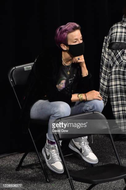 Megan Rapinoe watches the game between the New York Liberty and Dallas Wings on September 13 2020 at Feld Entertainment Center in Palmetto Florida...