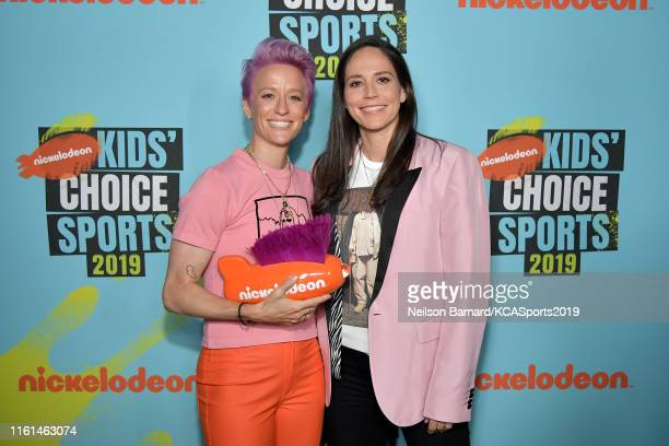 Megan Rapinoe, winner of the Generation Change award, and Sue Bird attend Nickelodeon Kids' Choice Sports 2019 at Barker Hangar on July 11, 2019 in...
