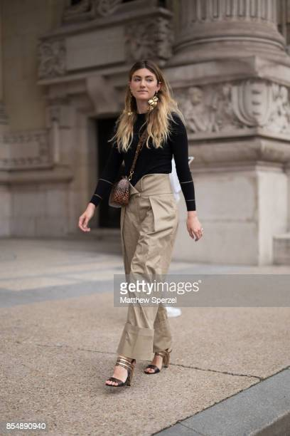 Megan Reynolds is seen attending Maison Margiela during Paris Fashion Week wearing Preen Ferragamo Simon Rocha Balenciaga on September 27 2017 in...