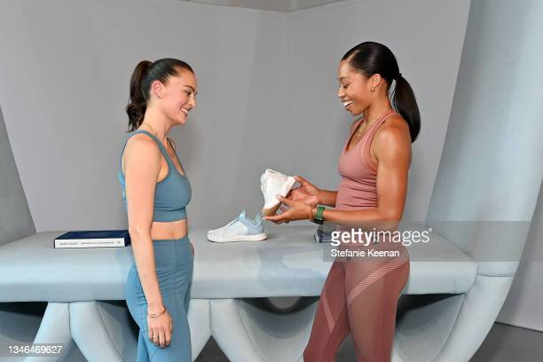 Megan Roup and Allyson Felix attend a work out led by Megan Roup from The Sculpt Society as Olympian Allyson Felix opens Saysh's new experiential...