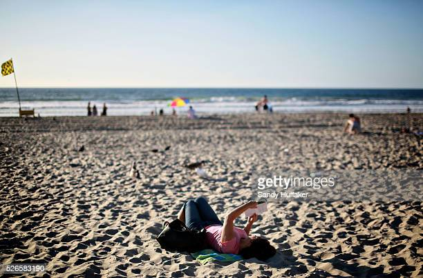 Megan Sanchez reads a book on the sand along Mission Beach in San Diego CA on Monday October 27 2014