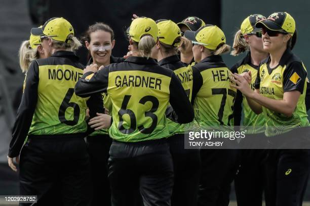 Megan Schuff of Australia celebrates with teammates after taking a wicket during the Twenty20 women's World Cup cricket match between Australia and...