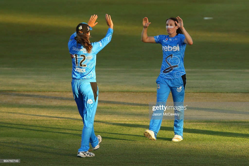 Megan Schutt and Alex Price of the Strikers celebrate a wicket during the Women's Big Bash League match between the Perth Scorchers and the Adelaide Strikers at Traeger Park on January 14, 2018 in Alice Springs, Australia.