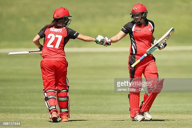 Megan Schutt and Sam Betts of the Scorpions bump fists during the WNCL match between South Australia and Queensland at Railsways Oval on November 21...