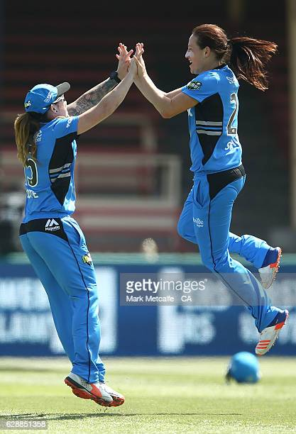 'SYDNEY AUSTRALIA DECEMBER 10 Megan Schutt and Sarah Coyte of the Strikers celebrate taking the wicket of Grace Harris of the Renegades during the...