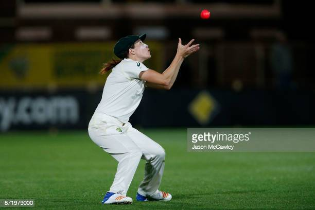Megan Schutt of Australia catches Georgia Elwiss of England during the Women's Test match between Australia and England at North Sydney Oval on...