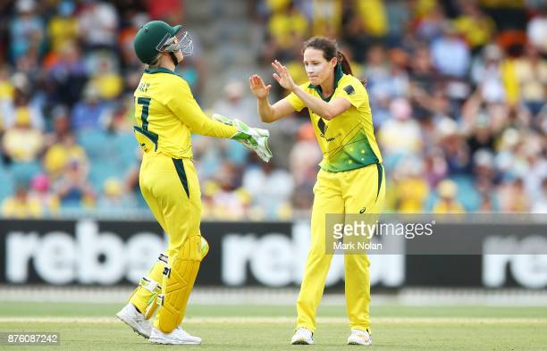 Megan Schutt of Australia celebrates a wicket with team mates during the second Women's Twenty20 match between Australia and England at Manuka Oval...