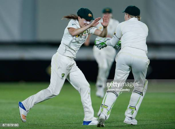Megan Schutt of Australia celebrates catching Georgia Elwiss of England off the bowling of Ellyse Perry of Australia during the Women's Test match...