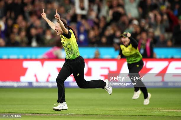 Megan Schutt of Australia celebrates taking the final wicket dismissing Poonam Yadav of India during the ICC Women's T20 Cricket World Cup Final...