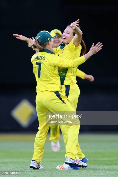 Megan Schutt of Australia celebrates taking the wicket of Sarah Taylor of England during the first Women's Twenty20 match between Australia and...