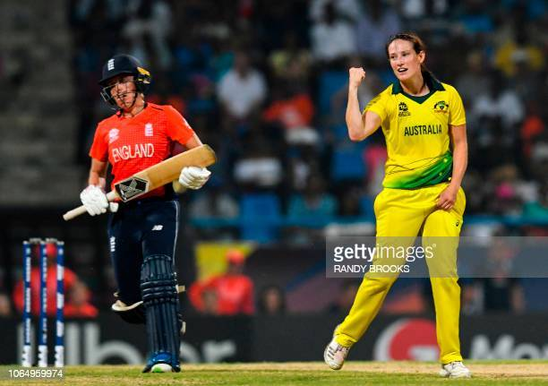 Megan Schutt of Australia celebrates the dismissal of Danielle Hazell of England during the ICC Women's World T20 final cricket match between...