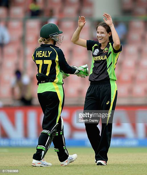 Megan Schutt of Australia celebrates with Alyssa Healy after dismissing Isobel Joyce of Ireland during the Women's ICC World Twenty20 India 2016...