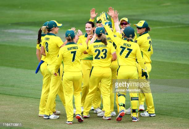 Megan Schutt of Australia celebrates with her teammates after dismissing Lauren Winfield of England during the 2nd Vitality Women's IT20 at The 1st...