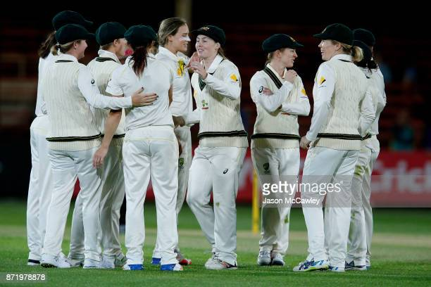 Megan Schutt of Australia celebrates with team mates after catching Georgia Elwiss of England off the bowling of Ellyse Perry of Australia during the...