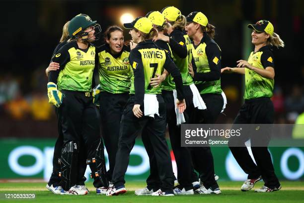 Megan Schutt of Australia celebrates with team mates after dismissing Dane Van Niekerk of South Africa during the ICC Women's T20 Cricket World Cup...