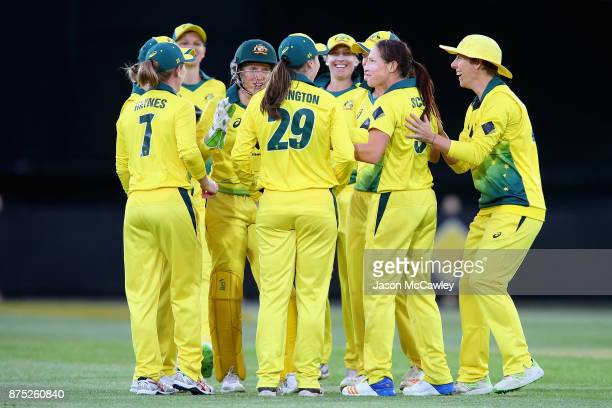 Megan Schutt of Australia celebrates with team mates after dismissing Sarah Taylor of England during the first Women's Twenty20 match between...