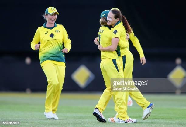 Megan Schutt of Australia celebrates with team mates after dismissing Sarah Taylor of England during the first Women's Twenty20 match between...