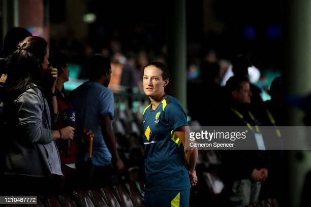 Megan Schutt of Australia is interviewed as heavy rain falls over Sydney prior to the ICC Women's T20 Cricket World Cup Semi Final match between...