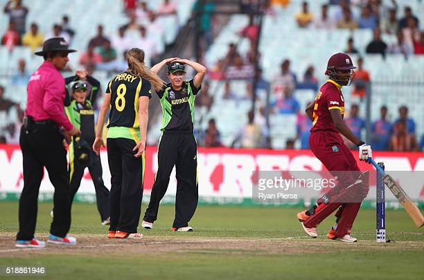 Megan Schutt of Australia misses a run out as west Indies score the winning runs during the Women's ICC World Twenty20 India 2016 Final match between...
