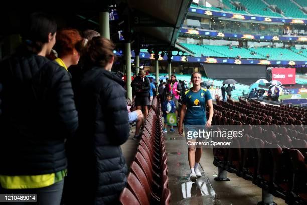 Megan Schutt of Australia walks through the members stand as rain falls ahead of the ICC Women's T20 Cricket World Cup Semi Final match between...