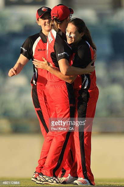 Megan Schutt of South Australia celebrates with Lauren Ebsary after the runout of Rene Farrell of New South Wales and winning the round one WNCL...