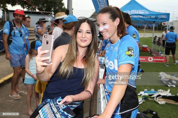 Megan Schutt of the Adelaide Strikers has a photo with a fan during the Women's Big Bash League match between the Adelaide Strikers and the Melbourne...