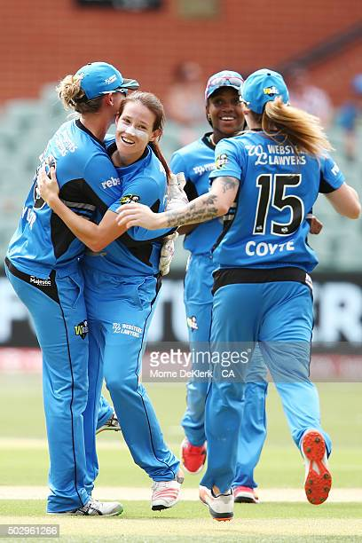 Megan Schutt of the Adelaide Strikers is congratulated by teammates after bowling out Chloe Piparo of the Perth Scorchers during the Women's Big Bash...