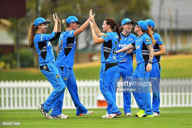 Megan Schutt of the Adelaide Strikers reacts after taking the wicket of Hayley Matthews of the Hobart Hurricanes during the WBBL match between the...