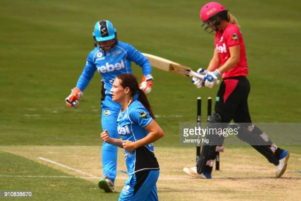 SYDNEY AUSTRALIA JANUARY Megan Schutt of the Strikers celebrates the wicket of Ellyse Perry of the Sixers during the Women's Big Bash League match...
