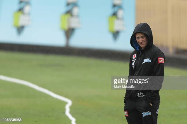 Megan Schutt of the Strikers inspects the pitch during a rain delay during the Women's Big Bash League WBBL match between the Sydney Sixers and the...