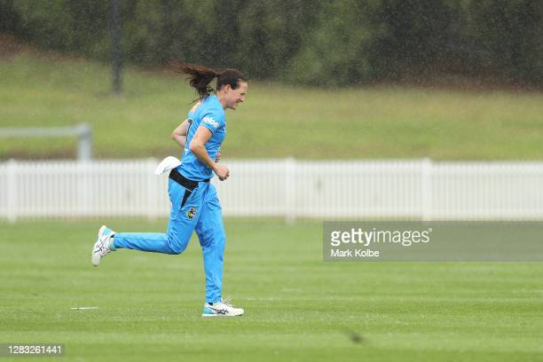 Megan Schutt of the Strikers leaves the field during a rain delay during the Women's Big Bash League WBBL match between the Adelaide Strikers and...
