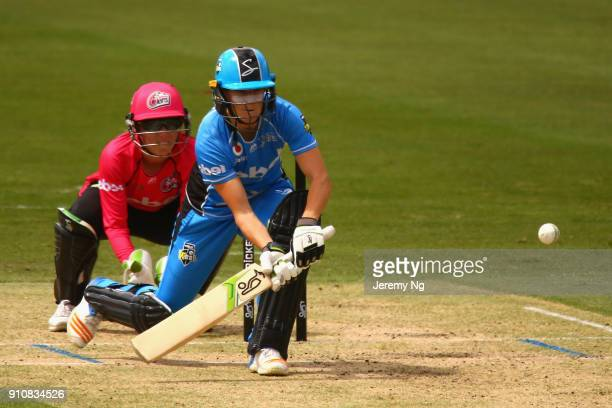 Megan Schutt of the Strikers plays a slog sweep during the Women's Big Bash League match between the Adelaide Strikers and the Sydney Sixers at...