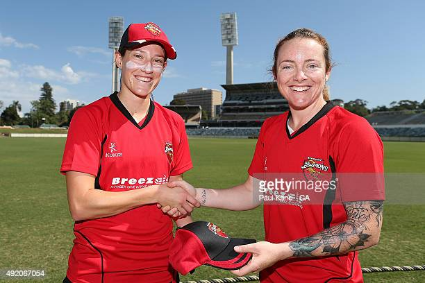 Megan Schutt presents Sarah Coyte with her cap during the round one WNCL match between New South Wales and South Australia at WACA on October 10 2015...
