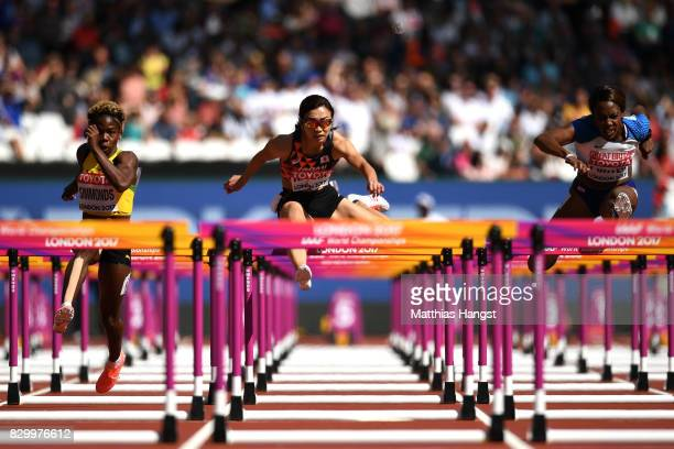 Megan Simmonds of Jamaica Ayako Kimura of Japan and Tiffany Porter of Great Britain compete in the Women's 100 metres hurdles heats during day eight...