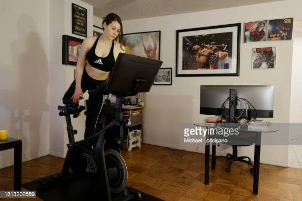 Megan Thompson prepares to work out on her SoulCycle exercise bike on April 18, 2021 in New York City. There is a competitive business war between...