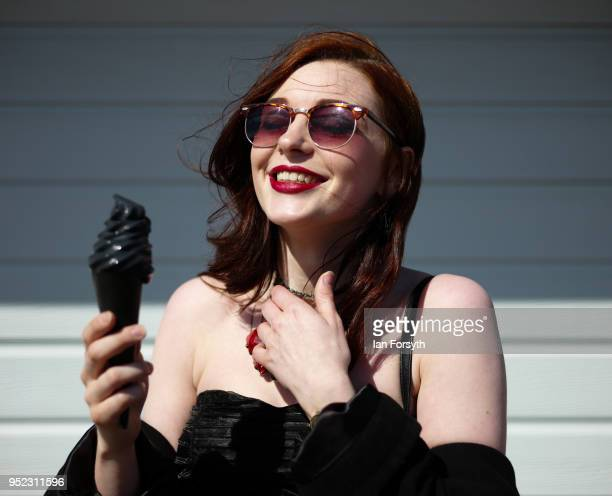 Megan Watts from Scarborough eats a special Goth Weekend ice-cream designed by Trillo's of Whitby during Whitby Gothic Weekend on April 28, 2018 in...