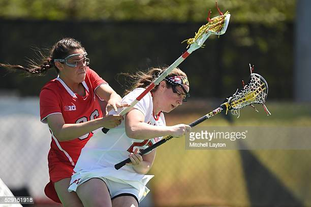 Megan Whittle of the Maryland Terrapins tries to get around Shannon Rosati of the Ohio State Buckeyes during a college women's lacrosse game at the...